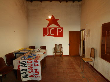 A logo for the party's youth wing on a wall in the Communist Party of Portugal's Borba office.