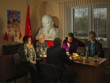 Members of the Communist Party of the Russian Federation (KPRF) gathered around a desk in the Borovichi office. (L-R) Tatyana Lukina, chairwoman of the veterans' organisation Children of the War and h...