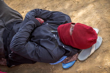 Exhausted members of a group of migrants who were left in the desert between Arlit and Assamaka on the Algerian border by their people smuggler after the group was robbed twice by local bandits and tw...