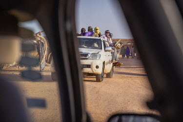 A group of illegal migrants begin the journey through the Sahara in a people smuggler's vehicle.