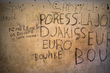Graffiti left on a wall in a migrant's safe-house by those departing before they attempt the perilous journey across the Sahara Desert.