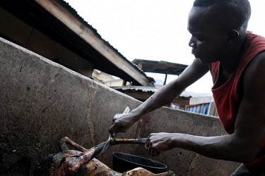 A butcher cutting up a duiker carcass in Atwemonom the main bushmeat market in Kumasi. Bushmeat is a delicacy in Ghana, but there are concerns that unsafe practices in the killing and preparation of b...