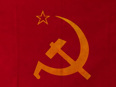 A Hamer and Sickle flag in the office of the Communist Refoundation Party (PRC).