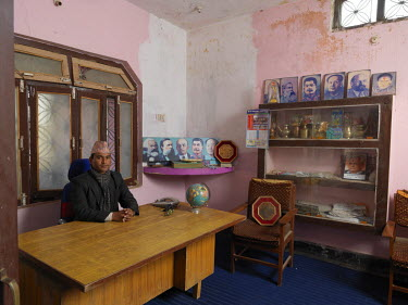 District chairman Akal Bahadur Bam 'Rabindra' in his office at the United Communist Party of Nepal (Maoist) district office.