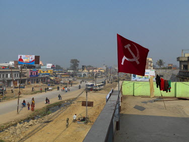 A Hammer and Sickle flag flies from the roof of the Communist Party of Nepal (Revolutionary Maoist), aka CPN-Maoist (Baidya) district contact office.