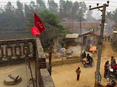 Flags fly from the roof of the United Communist Party of Nepal (Maoist), aka UCPN (M) regional (or Constituency) office.