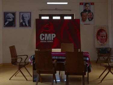 The Meeting Hall in the Communist Marxist Party's C.P. John HQ. The portraits are (R): Top, A.K.G. Bott L: M. V. Raghavan, founder of CMP (both factions). Bott R: C.P. John, party's general secretary....