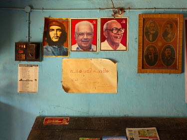 Portraits on the wall of Che Guevara, E.K. Nayanar (former senior party leader and chief minister), and Elamkulam Manakkal Sankaran Namboodiripad ('EMS') at the Communist Party of India Marxist CPI(M)...