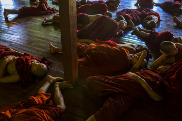 Novice monks, many of whom are orphans, taking an afternoon nap at the Shwe Gu monastery.