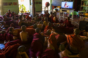 Novice monks, many of whom are orphans, watch a cartoon, as part of an English language course, at the Shwe Gu Buddhist monastery.