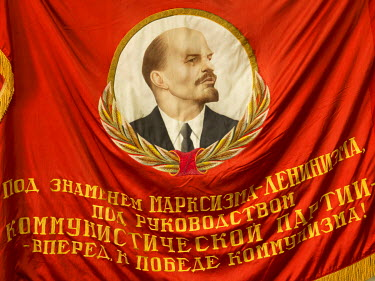 A woven Lenin banner in the KPRF Rykom (rayon committee) office in the Fokin district.