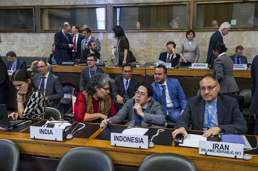 A japanese diplomat squats down, in discussion with an Indian representative before the begining of a plenery meeting of the Confeence on Disarmament. The CD is the only multi-lateral standing body fo...