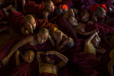 Buddhist novice monks watch a cartoon called Moana as part of an English lesson at Shwe Gu Buddhist monastery. Shwe Gu monastery and philanthrophic orphanage is home to around 85 Buddhist novices and...