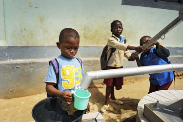 Pupils at the Notre Dame orphanage and school pumps water from the school's newly installed water pump.