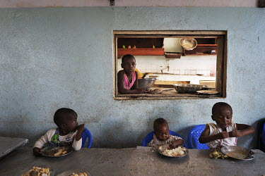 Children eating lunch in the canteen at the Notre Dame orphanage and school.