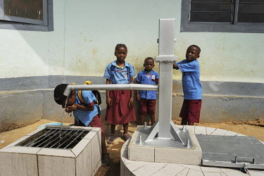 Pupils drinking water from the newly installed pump at the orphange Notre Dame orphanage and school.