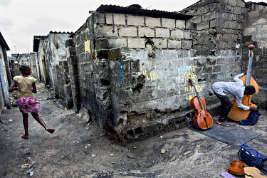 Albert Matuban Nlandu, a member of the Kimbanguist Church Symphony Orchestra, in his yard in the neighbourhood of Yolo, where he makes violins and cellos by copying other instruments.