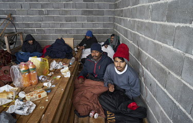 A group of migrants from Pakistan in an unfinished garage where they are squatting. They are all hoping to get to western Europe. For a few months they were living in a private house but the police pi...