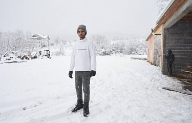 A migrant from Pakistan Qasim (17) standing beside an unfinished garage where he is squatting with other Pakistani migrants. They are all hoping to get to western Europe. For a few months they were li...