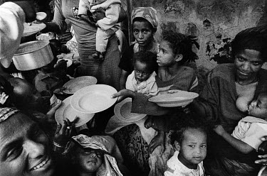 Destitute mothers, with their malnourished children, are fed at the Agoheld clinic. The Agoheld Primary school, where the clinic is held, provides free education to orphans and destitute children.