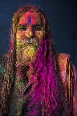 A sadhu, or holy man, smeared with coloured powder during the Lathmar Holi spring festival.