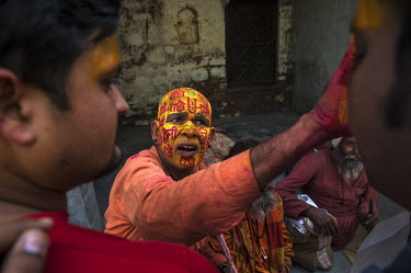 A crowd of people smeared with coloured paint during the Lathmar Holi spring festival.