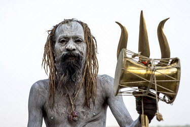 An Aghori, or ascetic Shiva sadhu, who smear themselves with the white ashes of cremated Hindus.