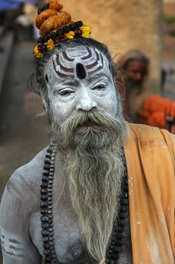 A Sadhus (Hindu holy man) on the ghats along the banks of the River Ganges.