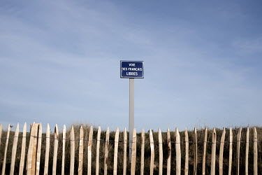 A sign reads: 'Voie Des Francais Libres' (Free French Way) at Juno Beach near Courseulles-Sur-Mer. Juno, was one of five landing sites along the Normandy coast where allied forces landed on D-Day, 6 J...