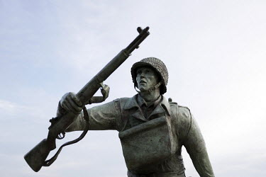 A statue of an American soldier above Omaha Beach, one of the five landing sites along the Normandy coast where allied forces landed on D-Day, 6 June 1944, as Operation Overlord, the invasion of weste...
