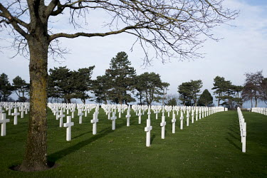 Headstones mark graves at the American Cemetery at Colleville-Sur-Mer, near Omaha Beach. The beach was one of the five landing sites along the Normandy coast where allied forces landed on D-Day, 6 Jun...
