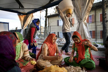 Women prepare vegetables for a meal to be eaten following a parade, to celebrate Vasakhi (Harvest Festival), through the town's streets. Around 12,000 Sikh migrants, and their Italian born children, r...