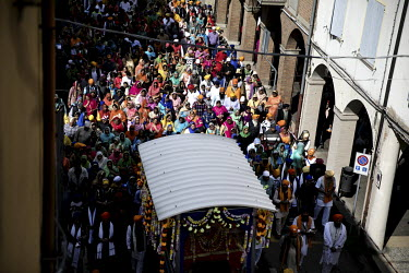 A crowd of around 12,000 Sikh migrants and their Italian born children, representing the Sikh community of the Po Valley and beyond, parade through the town's streets past the Gurdwara Singh Sabha Sik...