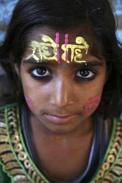 A girl with puja mark on her forehead.