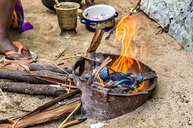 Yakawa Bawa Abacha makes a fire to cook pasta on. Yakawa Bawa Abacha lives with her five children and her husband in an informal IDP camp in Diffa. She struggles to buy food for her children who often...