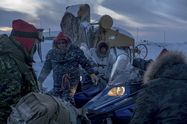 Inuit Rangers with their snowmobiles at Resolute Bay.