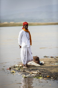 Hindu devotees gather to bathe in the holy water of Ganges River during the Ganga Sagar Snan mela. It is believed that by performing this ritualistic bath, all the sins of the person will be washed aw...