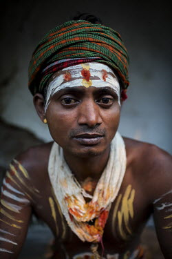 A Hindu youth with 'tilaka' markings on his forehead.