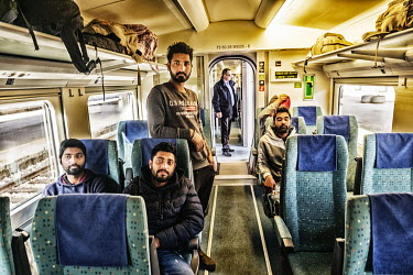 Pakistani refugees on the Sarajevo-Velika Kladusa train. From Velika Kladusa they hope to cross the Croatian and Slovenian borders on foot into western Europe.