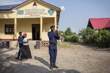 A policeman blows his trumpet outside the lcoal police station while another officer walks away with his wife, having just collected his salary. An agent from the bank comes to the town on a regular b...
