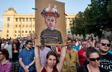 A protestor holds a painted placard of Andrej Babis with a stork's nest on his head during the biggest political protest since the fall of communism. About 120,000 people gathered in Wenceslav Square...