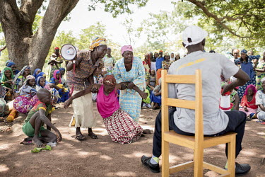Refugees watch a performance in Dosseye camp by people living with HIV who use theatre to educate about the disease, address stigmatisation, old myths about the disease and the need to seek medical tr...