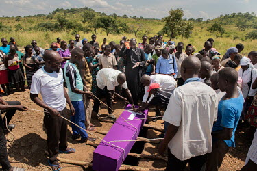 Lily Ipayi is lowered into a grave at her funeral in Bidibidi refugee settlement. She died aged around 42 or 43 having suffered from HIV/AIDS for a deacde. Lily and her family fled to Uganda when the...