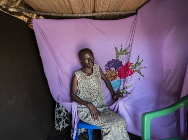 A few months before she died, Lily Ipayi posed for a portrait in front of an embroidered bedsheet she had made. She died aged around 42 or 43 having suffered from HIV/AIDS for a deacde. Lily and her f...
