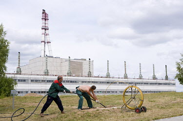 Workmen put cables in the ground near the Ignalina Nuclear Power Plant. Unit 1 was closed in December 2004, as a condition of Lithuania's entry into the European Union. The plant is similar to the Che...