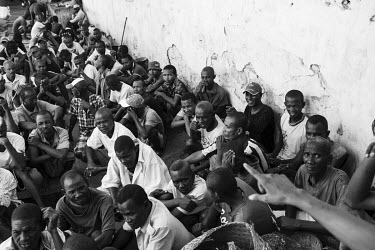 A group of inmates gather in a courtyard at Marofoto Prison (known to inmates as Marseilles) to receive a special daily feeding, provided by the Catholic church, for inmates showing signs of malnutrit...