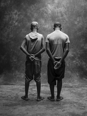 Houssen Ben Ali (left, 15), a juvenile detainee held in Mahajanga prison where he has been awaiting trial for four months on a charge in relation to a mugging. With him is Bruno Augustin Randria (righ...