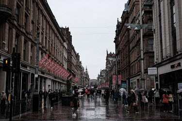 Shoppers throng onto Buchanan Street. The city centre's busy streets provide funds for its many drug addicts many of whom are homeless and beg seven days a week to fund their dependence on Class A dru...