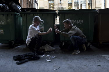 James Muir and his friend Tony cook up their heroin in a back street car park, after buying from a dealer just outside town. Tony is now on a methadone program ensuring that he does not have to use mo...