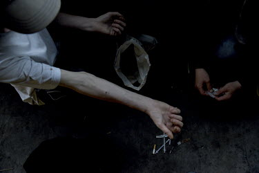 James Muir and his friend Tony injecting heroin in a back street car park, after buying from a dealer just outside town. Tony is now on a methadone program ensuring that he does not have to use more t...